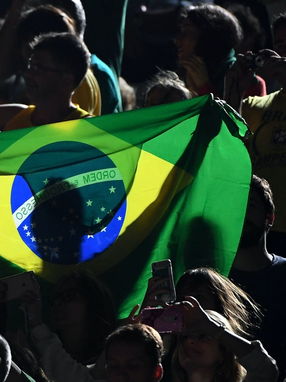 RIO DE JANEIRO, BRAZIL - AUGUST 17:  Brazilian fans show their support during the Beach Volleyball Women's Gold medal match Brazil and Germany on day 12 of the Rio 2016 Olympic Games at the Beach Volleyball Arena on August 17, 2016 in Rio de Janeiro, Brazil.  (Photo by Quinn Rooney/Getty Images)