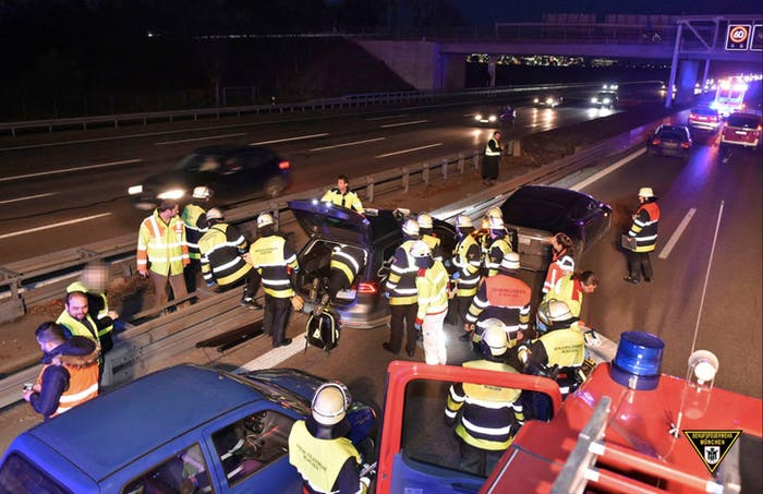 Firefighters in Munich, Germany, respond to the crash where a Tesla Model S stopped an out of control Volkswagen Passat.