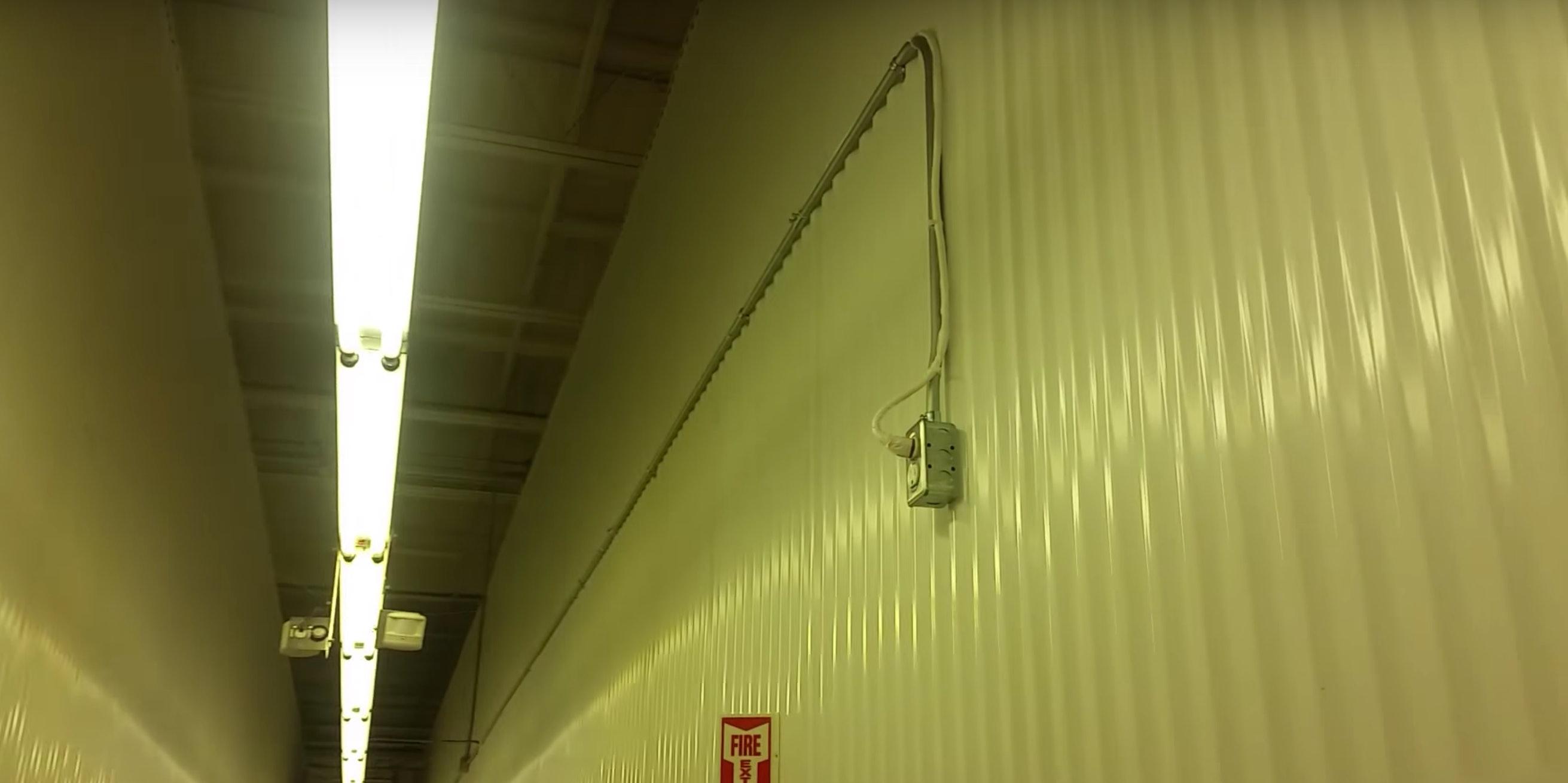 wire running down hallway of storage unit