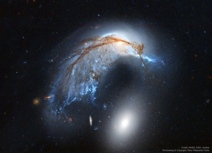 NGC 2936 (above) and NGC 2937 (below) look a lot like a penguin and his egg.
