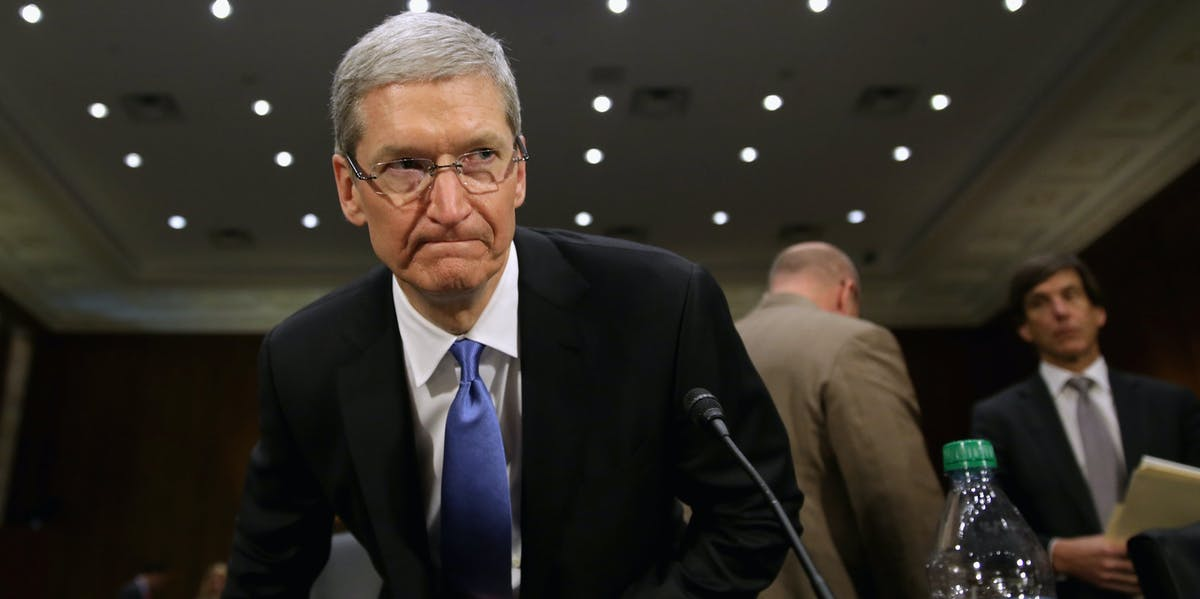 WASHINGTON, DC - MAY 21:  Apple CEO Timothy Cook returns from a break in his testimony before the Senate Homeland Security and Governmental Affairs Committee's Investigations Subcommittee about the company's offshore profit shifting and tax avoidance in the Dirksen Senate Office Building on Capitol Hill May 21, 2013 in Washington, DC. A Congressional report released Monday said that Apple, America's most profitable technology company, used a complex system of international subsidiaries and tax avoidance efforts to shift at least $74 billion from the reach of the Internal Revenue Service between 2009 and 2012.  (Photo by Chip Somodevilla/Getty Images)
