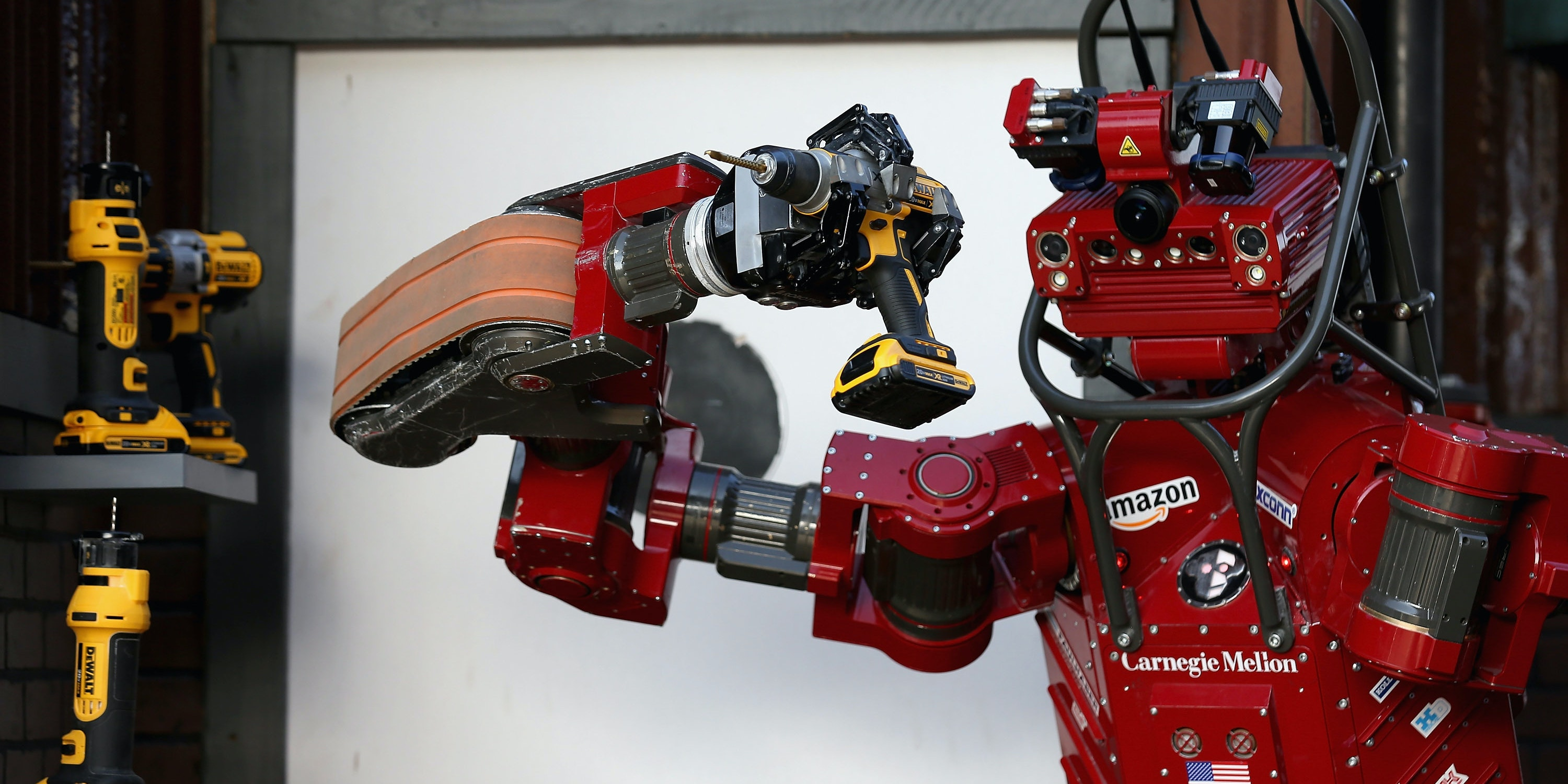 POMONA, CA - JUNE 06: Team Tartan Rescue's CHIMP (CMU Highly Intelligent Mobile Platform) robot uses a hand-held power tool during the cutting task of the Defense Advanced Research Projects Agency (DARPA) Robotics Challenge at the Fairplex June 6, 2015 in Pomona, California. Built by Carnegie Mellon University-NREC, CHIMP took home a third prize check for $500,000. Organized by DARPA, the Pentagon's science research group, 24 teams from aorund the world are competing for $3.5 million in prize money that will be awarded to the robots that best respond to natural and man-made disasters.  (Photo by Chip Somodevilla/Getty Images)
