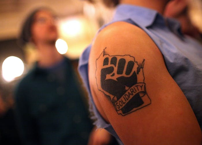 This tattoo could be used against you. (A solidarity tattoo is seen on the arm of a protestor during a demonstration inside the Wisconsin State Capitol on March 9, 2011 in Madison, Wisconsin.)