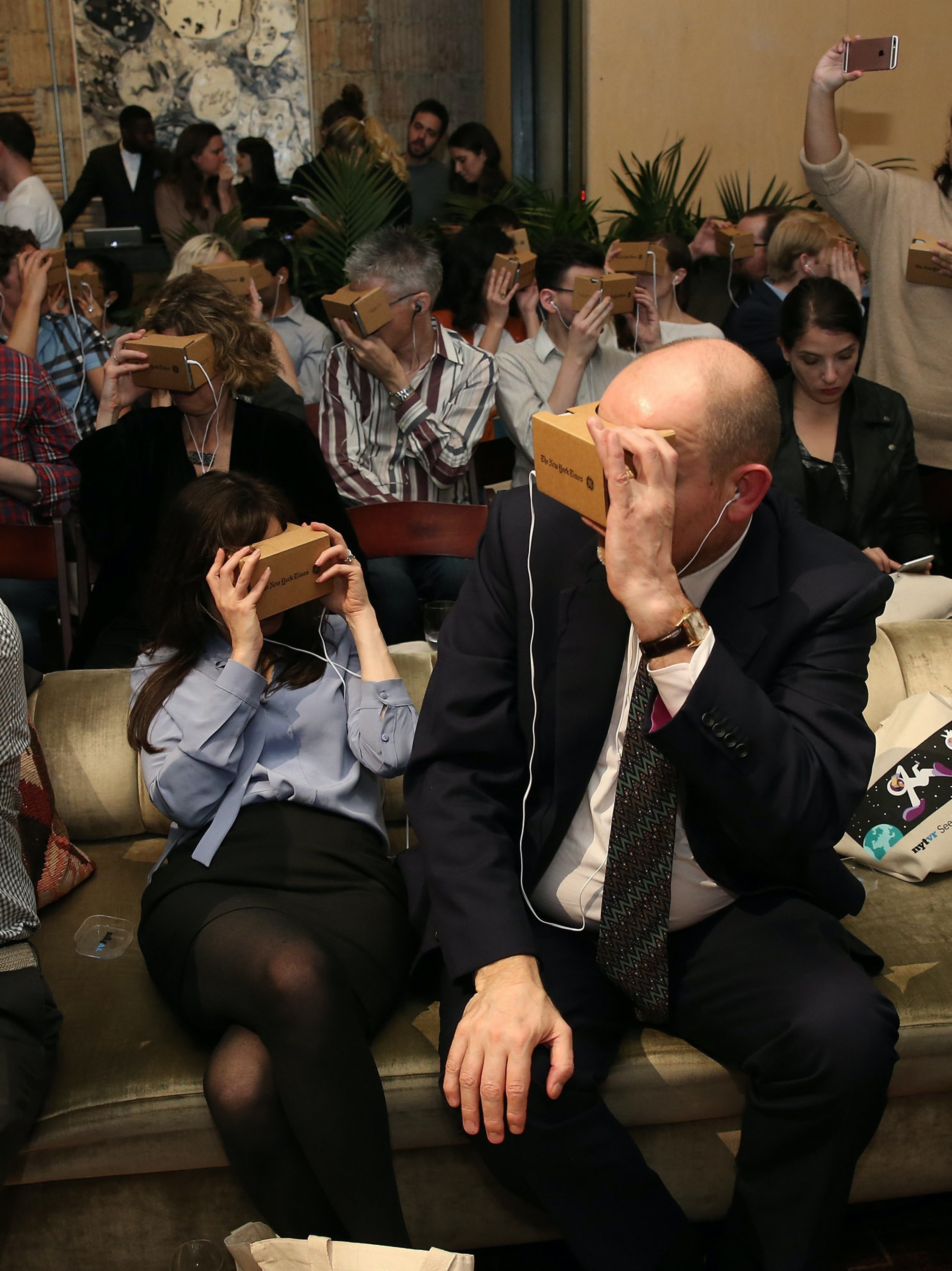 NEW YORK, NY - NOVEMBER 05:  (L-R) Head of Partnerships, Google Cardboard, Aaron Luber, The New York Times Company CRO, Meredith Kopiet Levien, CEO of the New York Times Company, Mark Thompson and Chris Milk attend The New York Times's NYTVR exclusive look event on November 5, 2015 in New York City.  (Photo by Neilson Barnard/Getty Images for New York Times)