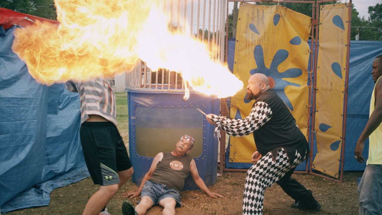 Someone who can breathe flames might be the single most helpful Carnival character in a zombie outbreak.