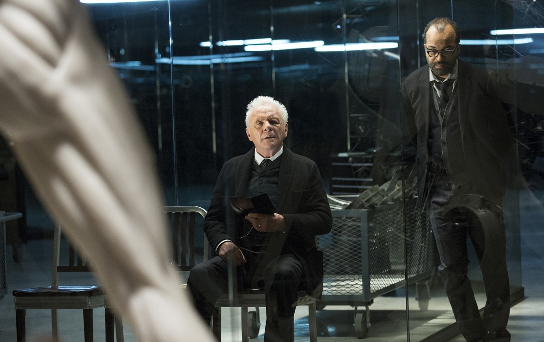 Anthony Hopkins as Dr. Robert Ford andJeffrey Wright as Bernard Lowe staring at...something.