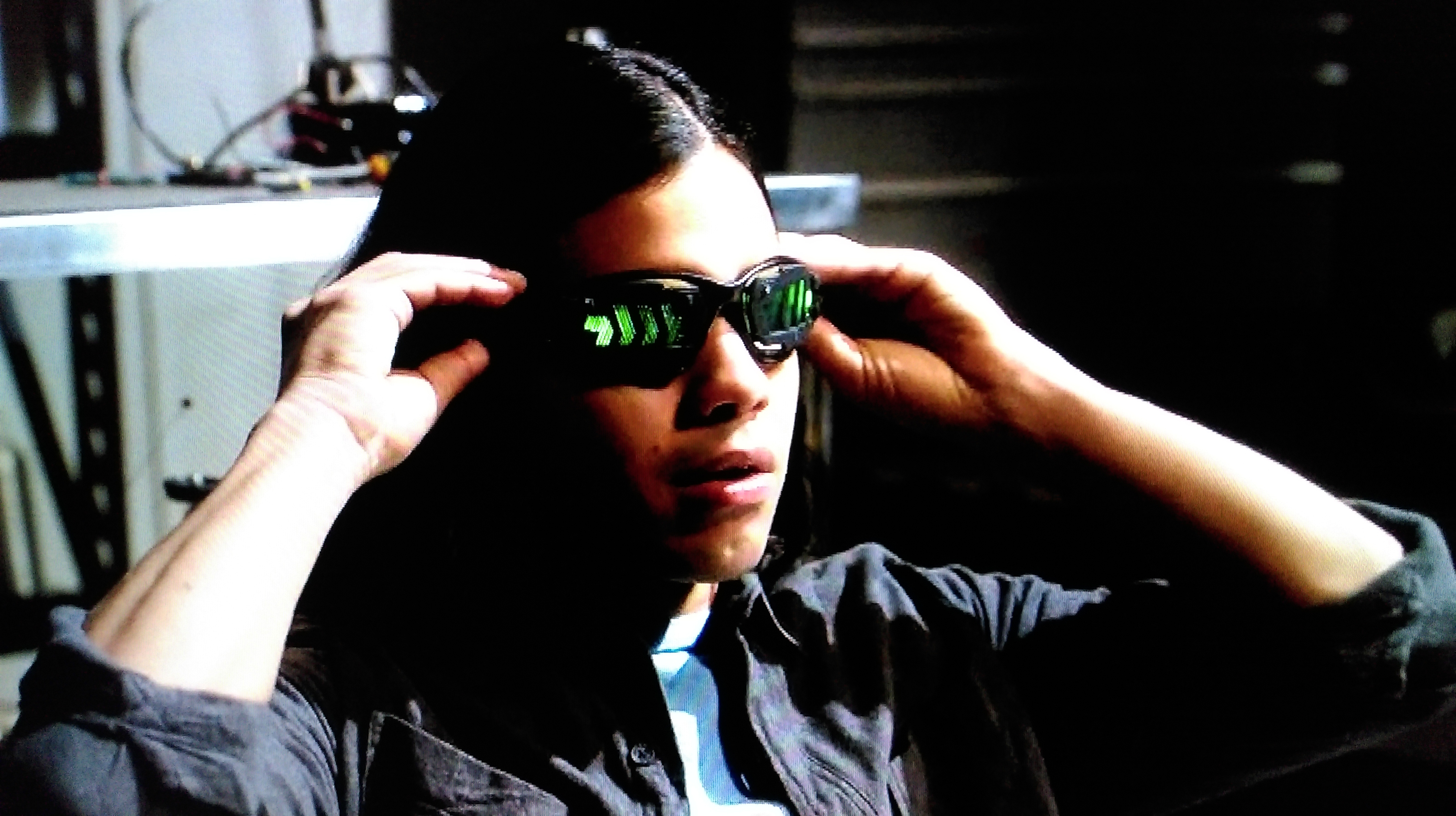 "Cisco tries on his new vibe-inducing goggles, on the CW show ""The Flash."""