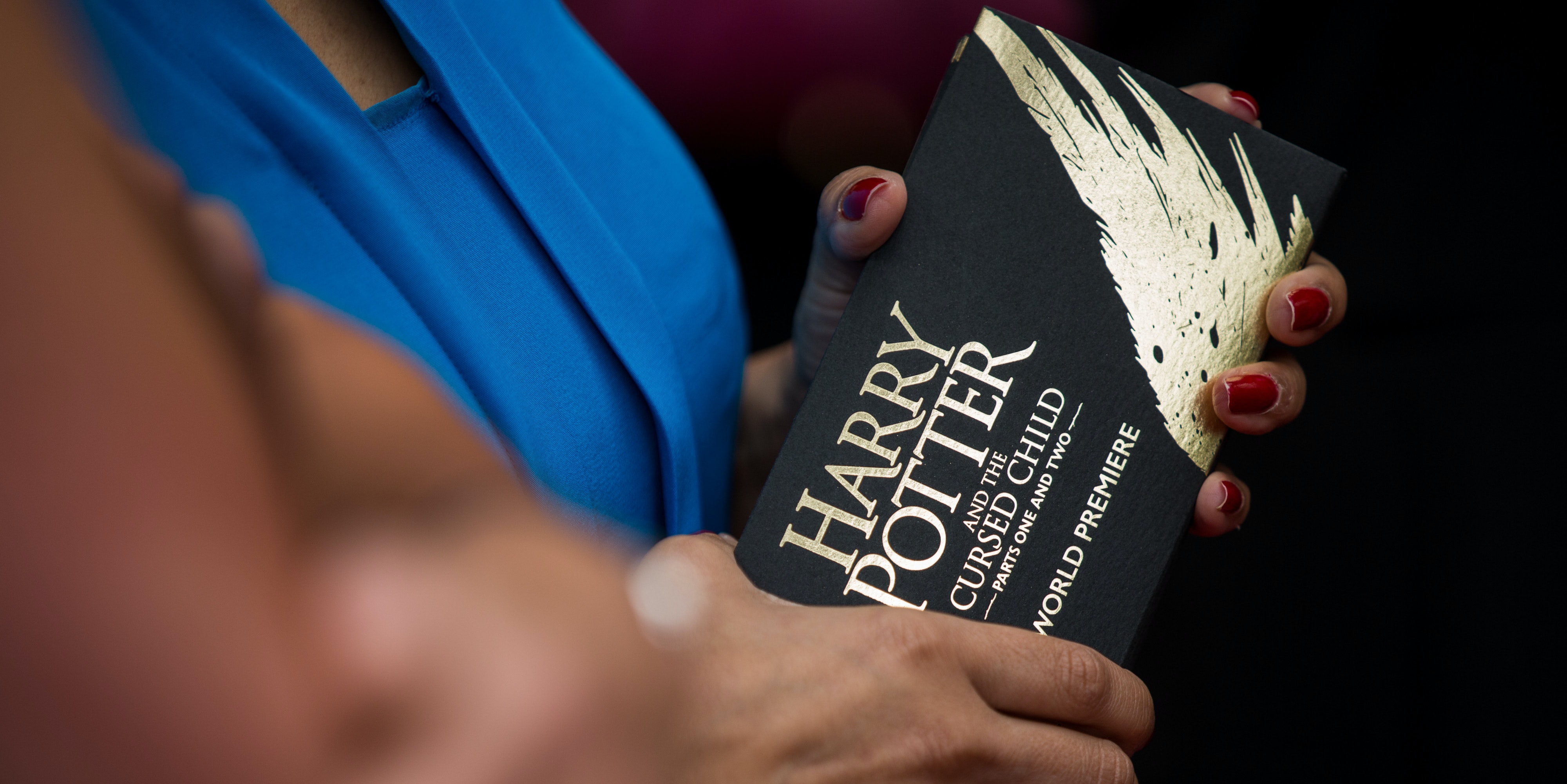 LONDON, ENGLAND - JULY 30:  A woman holds her tickets for 'Harry Potter & The Cursed Child' at Palace Theatre on July 30, 2016 in London, England. Harry Potter and the Cursed Child, is a two-part West End stage play written by Jack Thorne based on an original new story by Thorne, J.K. Rowling and John Tiffany.  (Photo by Rob Stothard/Getty Images)