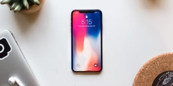 iPhone X on a desk.