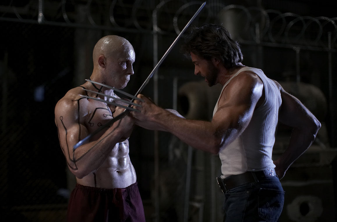 Ryan Reynolds, Hugh Jackman as Deadpool and Wolverine in 20th Century Fox X-Men Origins: Wolverine