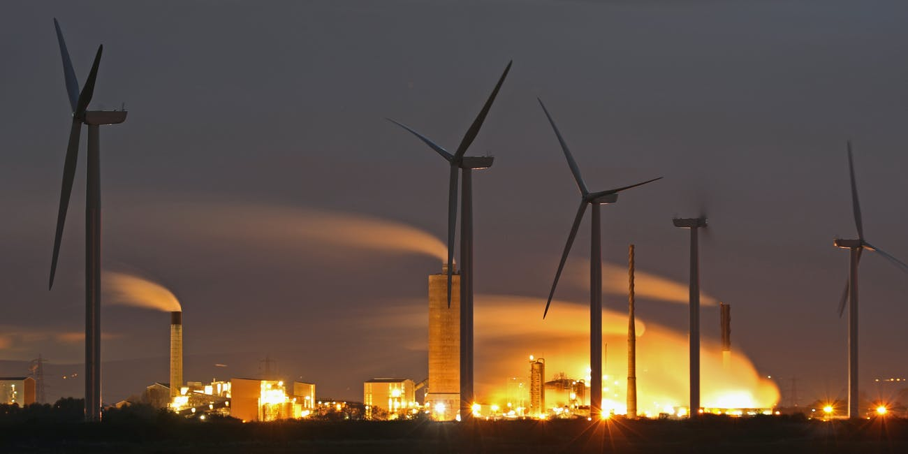 RUNCORN, ENGLAND - NOVEMBER 07: Wind Turbines are seen on Ince Salt Marshes near to chemical and manufacturing plants on the River Mersey estuary on November 7, 2016 in Runcorn, England. (Photo by Christopher Furlong/Getty Images)