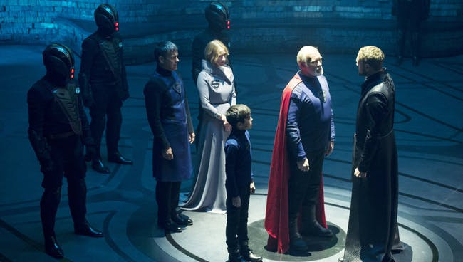 Superman's great-great grandfather Val-El (Ian McElhinney) faces a death sentence as Charys-El (Paula Malcomson), young Seg-El and his father (Rupert Graves) look on.