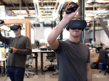 Facebook chief executive Mark Zuckerberg uses the Oculus Rift virtual reality headset and Touch controller.