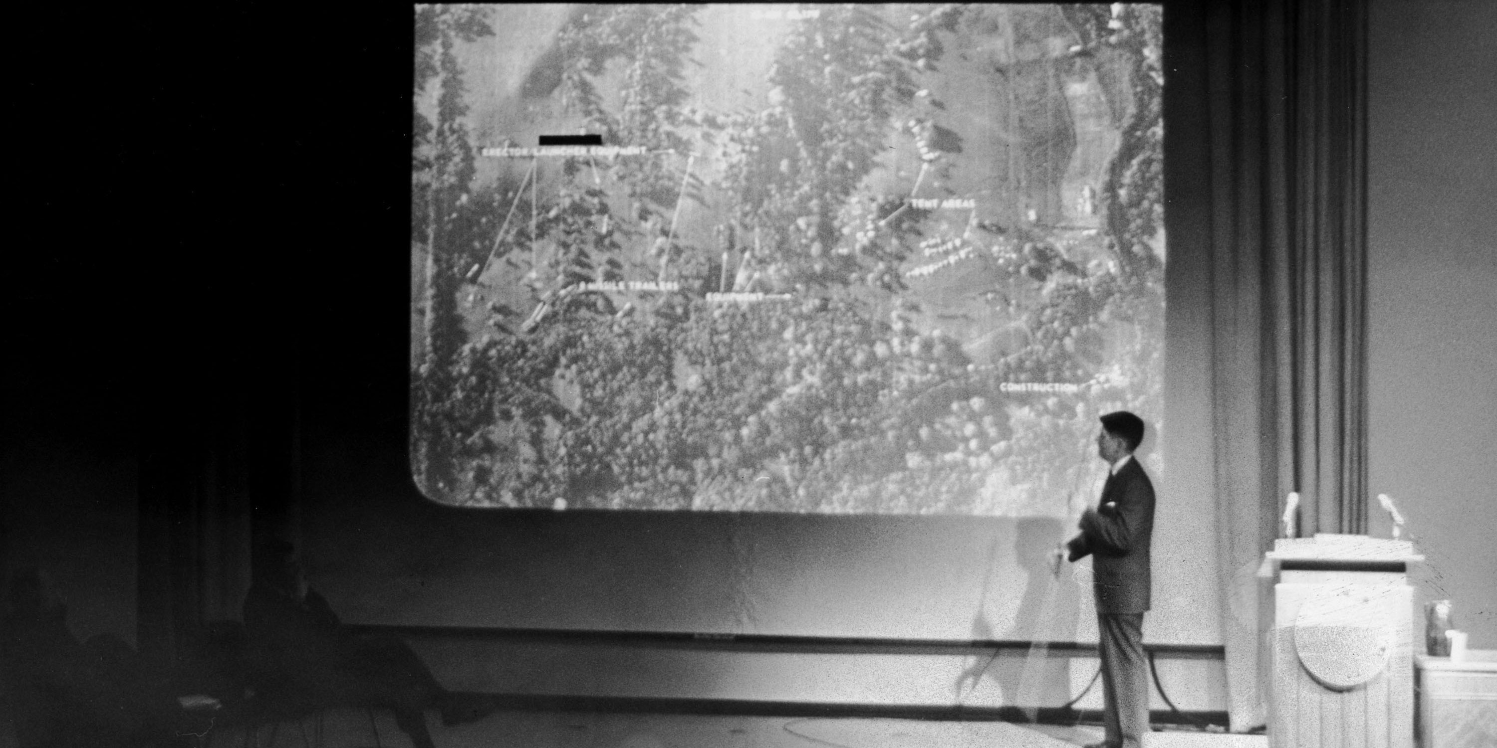 WASHINGTON - FEBRUARY 6, 1963:  (EDITORIAL USE ONLY)  (FILE PHOTO)  John Hughes, Special Assistant to the Director of Defense Intelligence, conducts a military briefing for the news media showing the absence of Soviet missiles in Cuba with an aerial map during the Cuban missile crisis February 6, 1963 in Washington, DC. Former Russian and U.S. officials attending a conference commemorating the 40th anniversary of the missile crisis October 2002 in Cuba said that the world was closer to a nuclear conflict during the 1962 standoff between Cuba and the U.S., than governments were aware of.  (Photo by Getty Images)