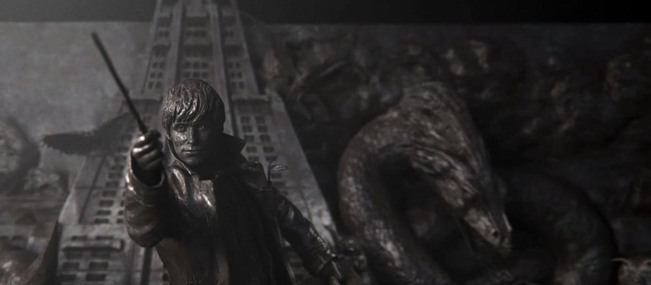 A statue of Newt Scamander stands in MACUSA