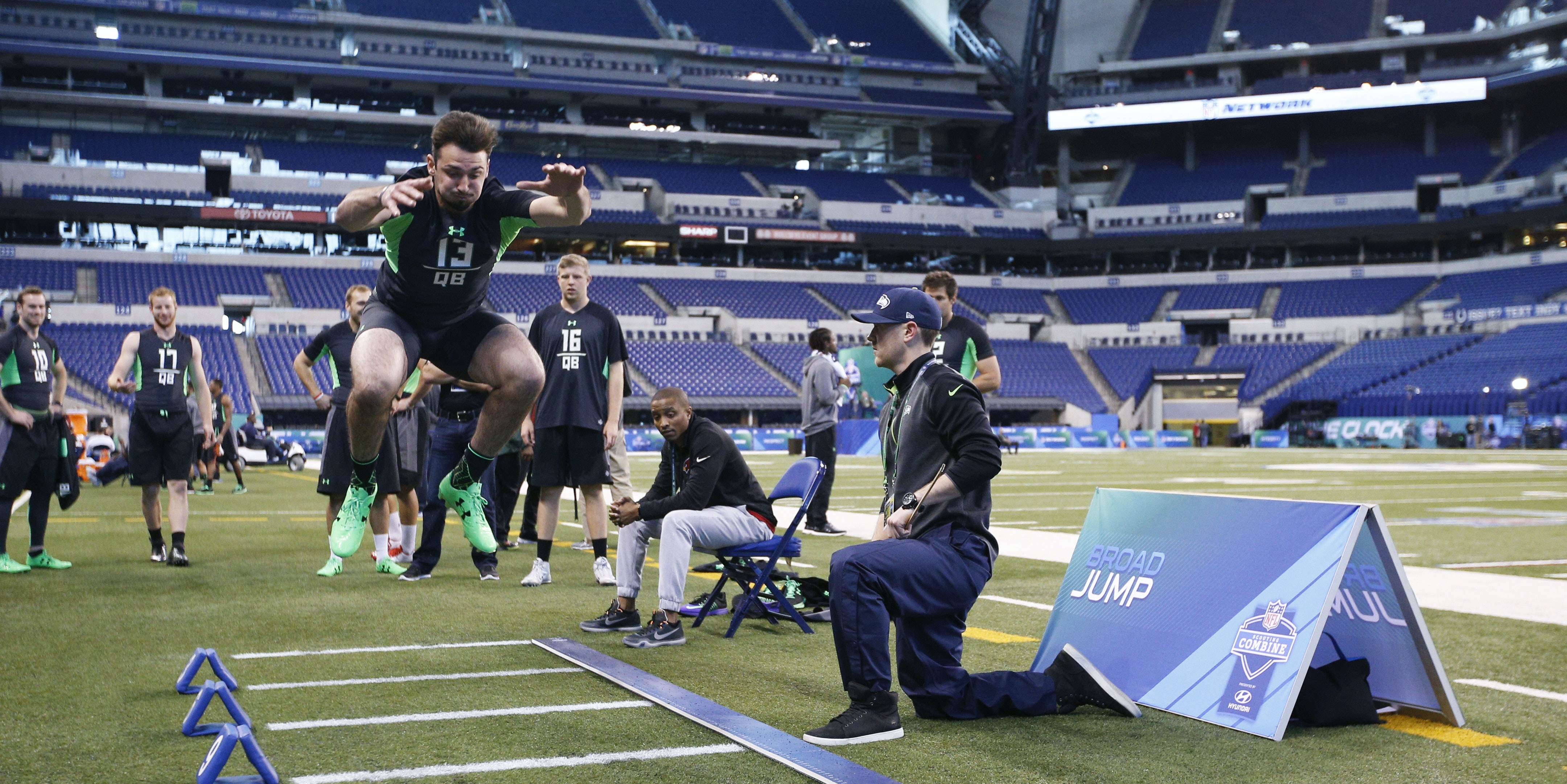 INDIANAPOLIS, IN - FEBRUARY 27: Quarterback Paxton Lynch of Memphis participates in the broad jump during the 2016 NFL Scouting Combine at Lucas Oil Stadium on February 27, 2016 in Indianapolis, Indiana. (Photo by Joe Robbins/Getty Images)