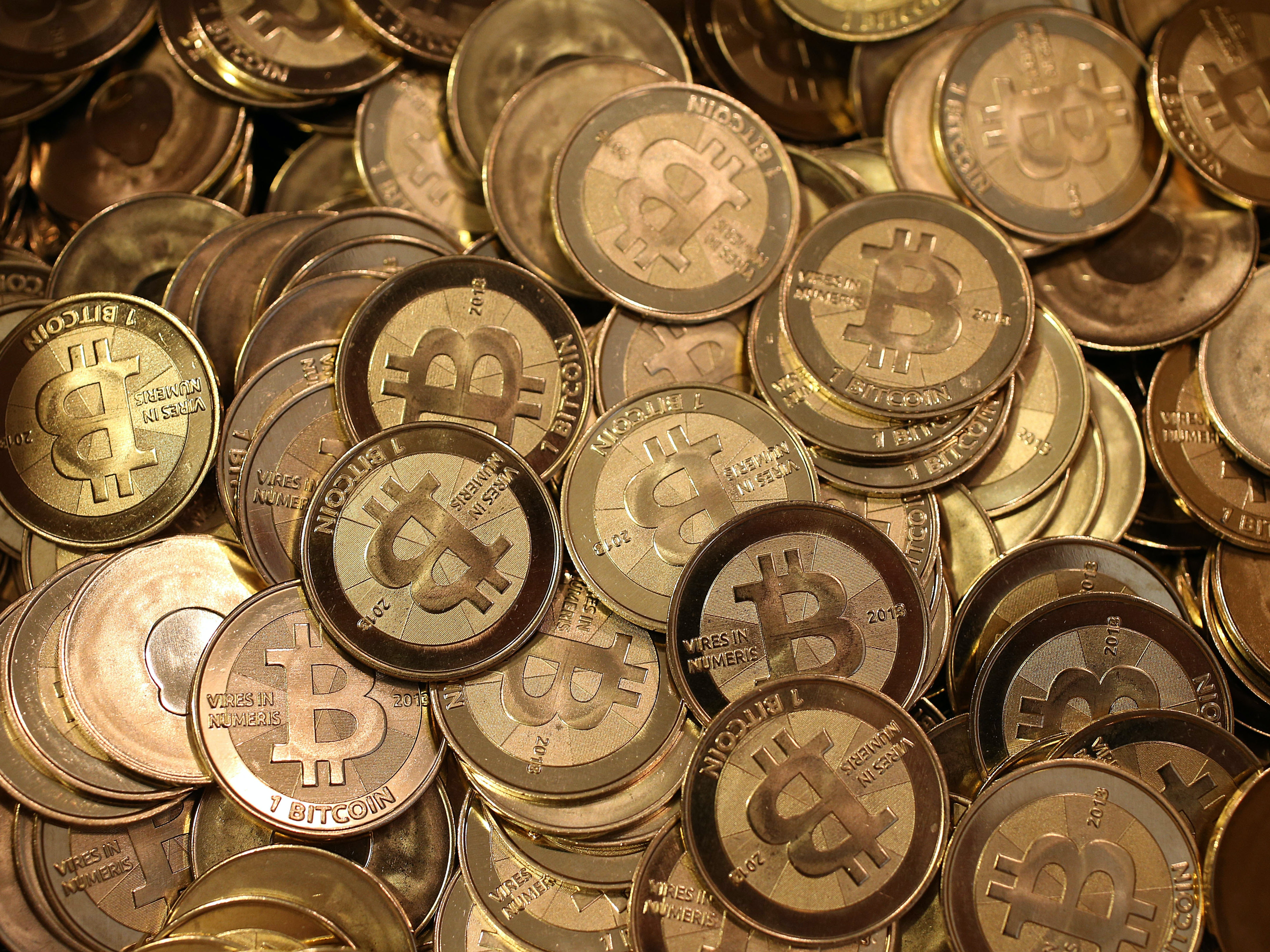 SALT LAKE CITY, UT - APRIL 26: A pile of Bitcoin slugs sit in a box ready to be minted by Software engineer Mike Caldwell in his shop on April 26, 2013 in Sandy, Utah. Bitcoin is an experimental digital currency used over the Internet that is gaining in popularity worldwide. (Photo by George Frey/Getty Images)
