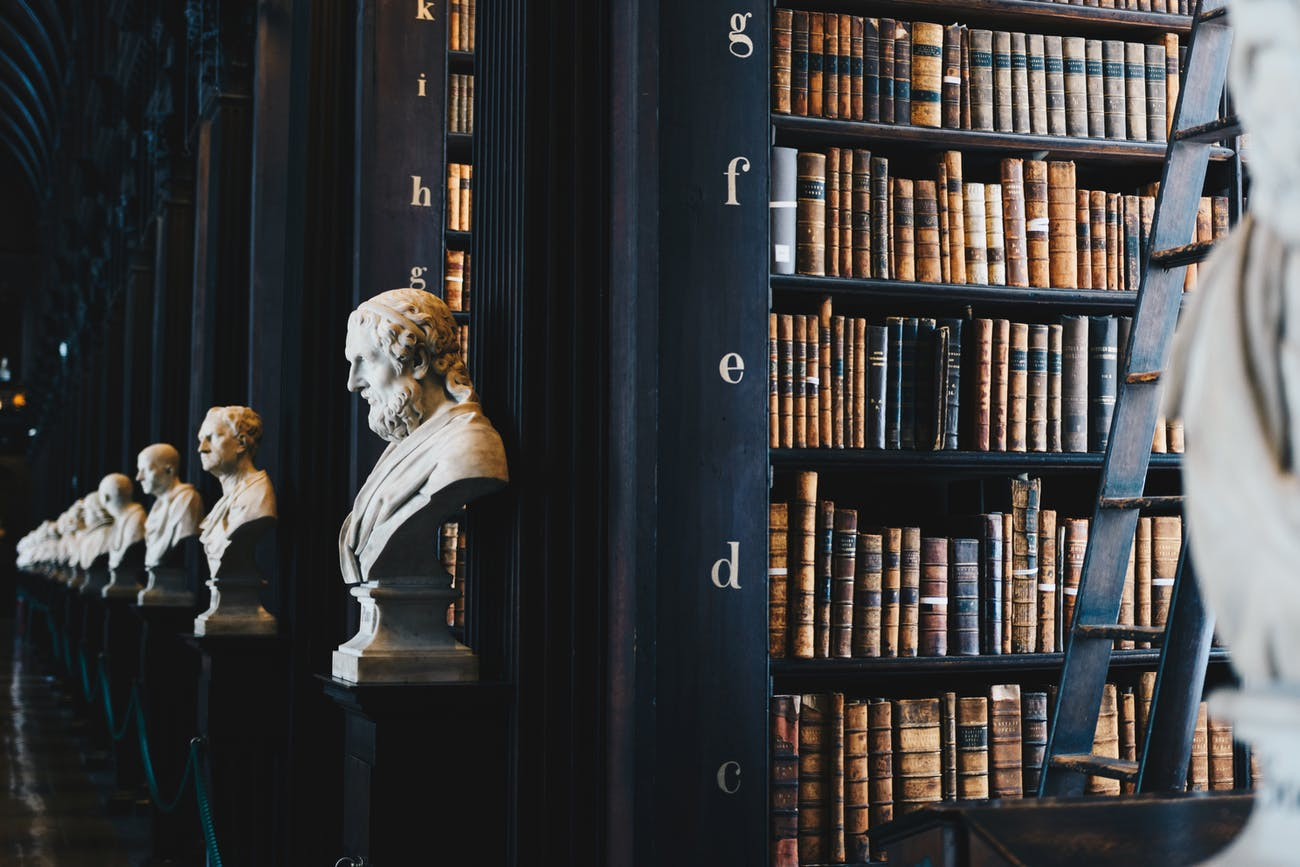 Library with books and statues