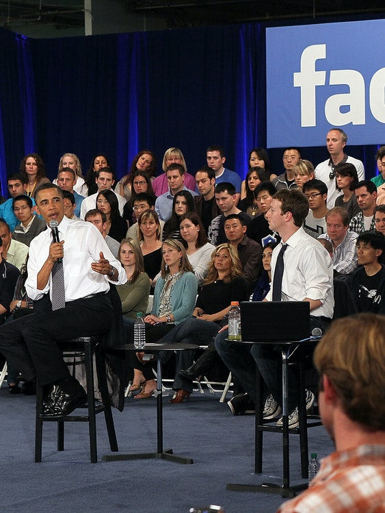 U.S. President Barack Obama (L) talks with Facebook CEO Mark Zuckerberg (R) during a town hall style meeting at Facebook headquarters on April 20, 2011 in Palo Alto, California. The president used the opportunity to outline his views on the budget deficit ahead of a looming battle with congressional Republicans over fiscal matters.