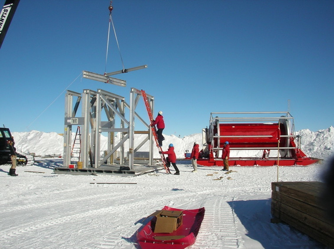 Construction of the support tower for the hot water drill used to melt holes 1.5 miles deep in the Antarctic ice to install IceCube sensors.