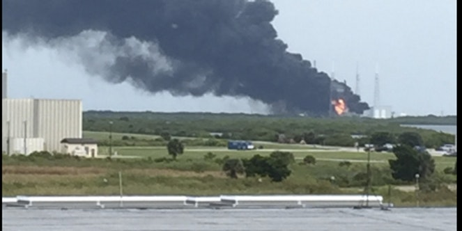 Huge Plume of Smoke Covers SpaceX Launch Pad at Kennedy Space Center