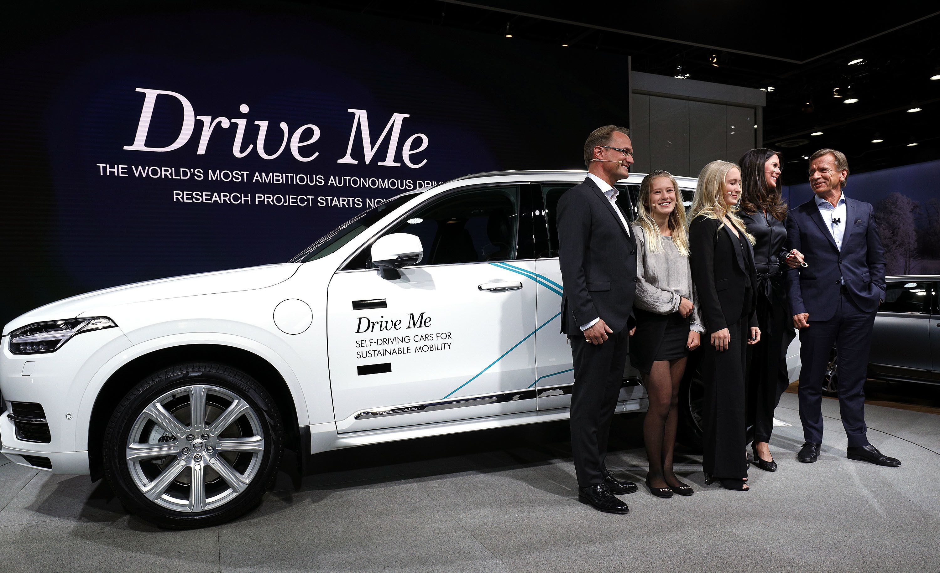 DETROIT, MI - JANUARY 9: Hakan Samuelsson (R), President and CEO, Volvo Car Group, stands with the Hain family from Sweden next to the autonomous Volvo vehicle they will be testing at the 2017 North American International Auto Show on January 9, 2017 in Detroit, Michigan. Approximately 5000 journalists from around the world and nearly 800,000 people are expected to attend the NAIAS between January 8th and January 22nd to see the more than 750 vehicles and numerous interactive displays. (Photo by Bill Pugliano/Getty Images)
