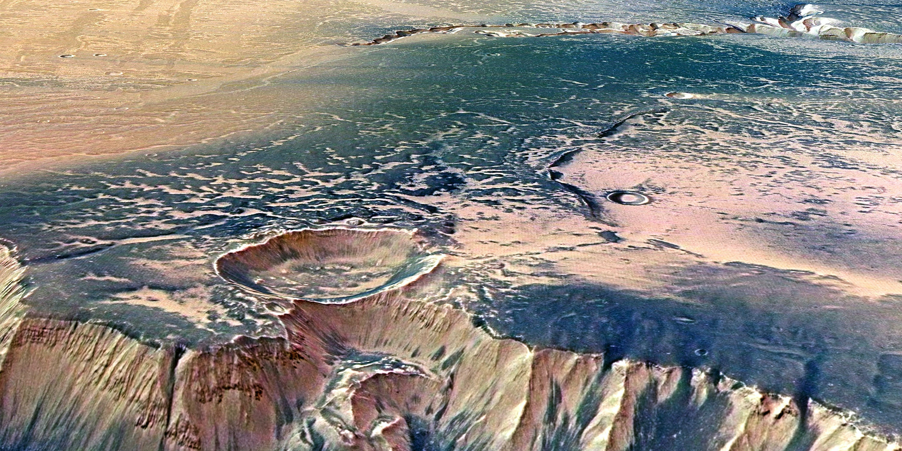 IN SPACE  - JULY 16:  In this handout image supplied by the European Space Agency (ESA) on July 16, 2008, The Echus Chasma, one of the largest water source regions on Mars, is pictured from ESA's Mars Express. The data was acquired on  September 25, 2005. An impressive cliff, up to 4000 m high, is located in the eastern part of Echus Chasma. Gigantic water falls may once have plunged over these cliffs on to the valley floor. The remarkably smooth valley floor was later flooded by basaltic lava.  (Photo by ESA via Getty Images)