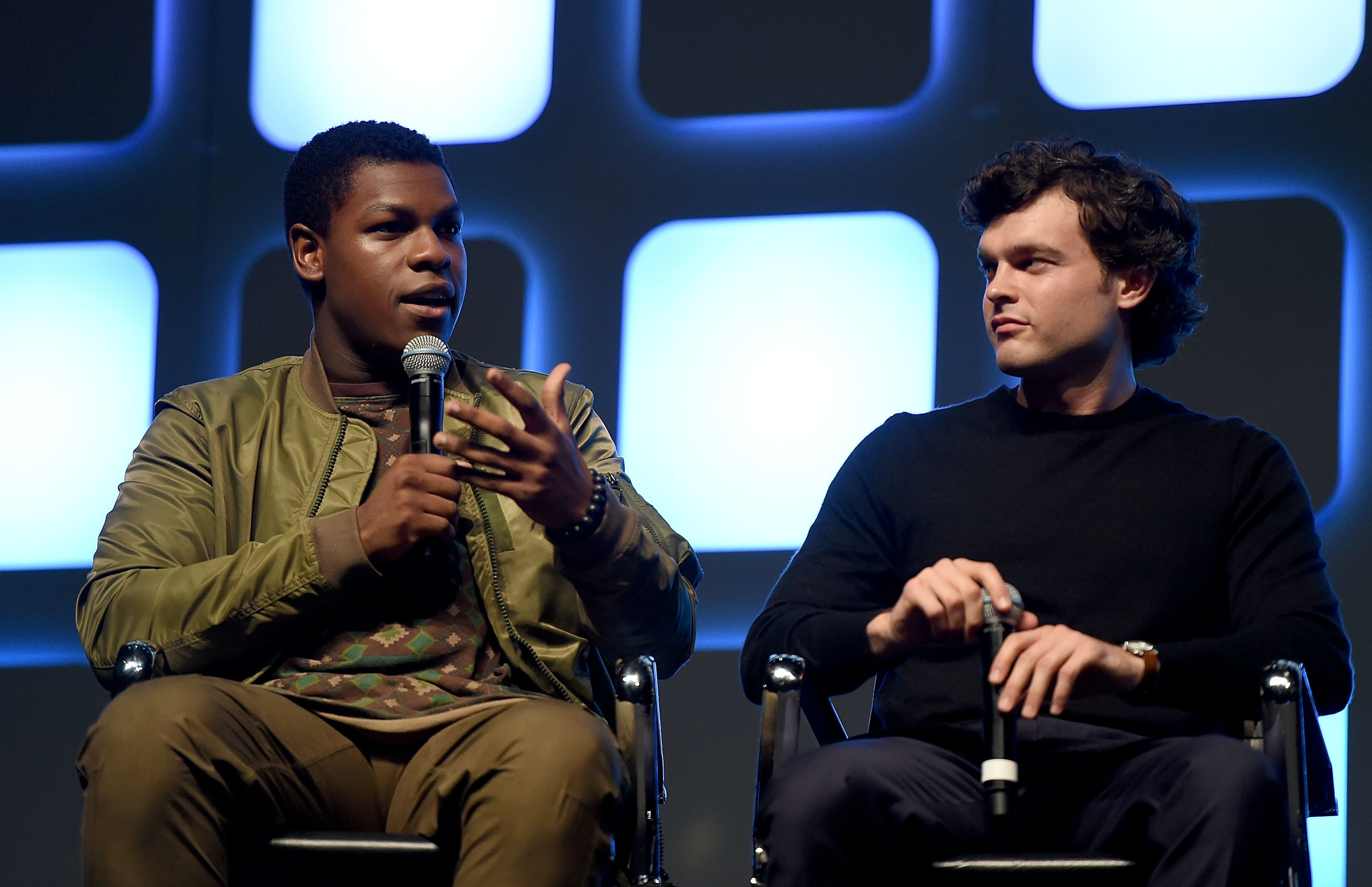 LONDON, ENGLAND - JULY 17:  John Boyega (L) and Alden Ehrenreich, who will play Han Solo, on stage during Future Directors Panel at the Star Wars Celebration 2016 at ExCel on July 17, 2016 in London, England.