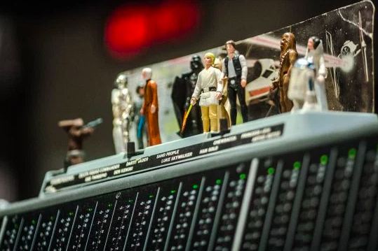Michael Giacchino's action figures hanging out on a mixing console during the recording of 'Rogue One' score.