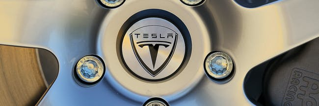 PALO ALTO, CA - MAY 20:  The Tesla Motors logo is seen on the wheel of a car at Tesla Motors headquarters May 20, 2010 in Palo Alto, California. Electric car maker Tesla Motors is set to annoucne a  partnership with Japanese automaker Toyota to make electric cars in California.  (Photo by Justin Sullivan/Getty Images)