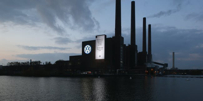 The Volkswagen logo as well as a banner that reads: 'We need transparency, openness, energy and courage. And above all we need: you.' adorns the main heating plant at the Volkswagen factory on November 12, 2015 in Wolfsburg, Germany.