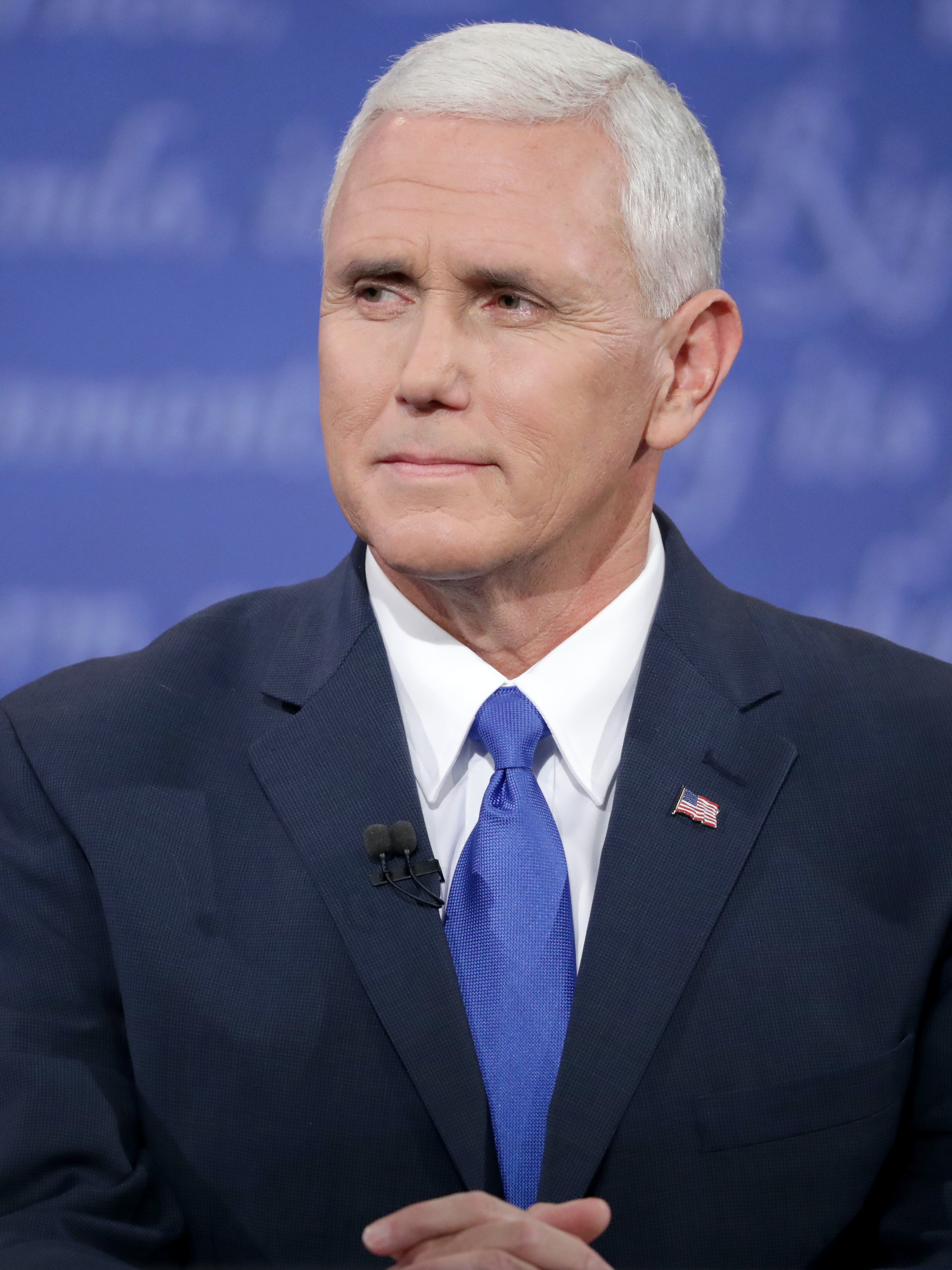 Republican vice presidential nominee Mike Pence listens during the Vice Presidential Debate with Democratic vice presidential nominee Tim Kaine at Longwood University on October 4, 2016 in Farmville, Virginia. This is the second of four debates during the presidential election season and the only debate between the vice presidential candidates.