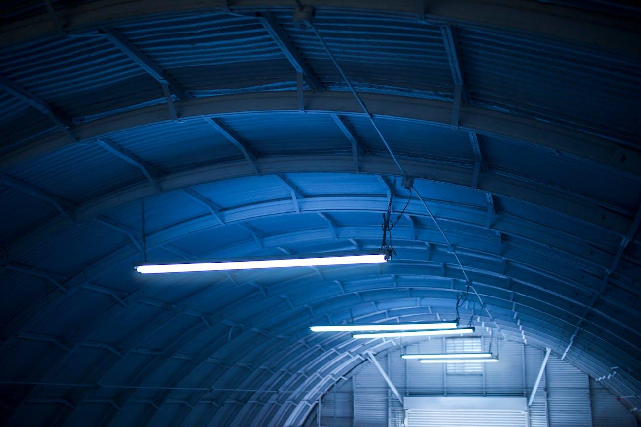 Mysterious lights inside what looks like a hangar.