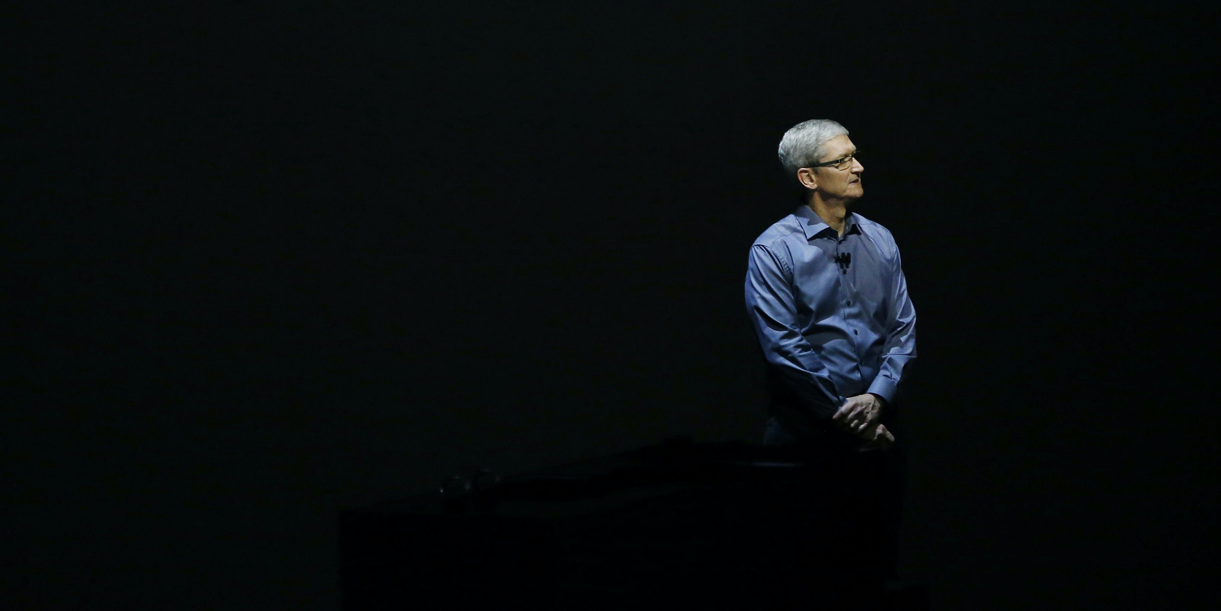 Apple CEO Tim Cook stands on stage during a Special Event at Bill Graham Civic Auditorium September 9, 2015 in San Francisco, California. Apple Inc. unveiled latest iterations of its smart phone, forecasted to be the 6S and 6S Plus and announced an update to its Apple TV set-top box.