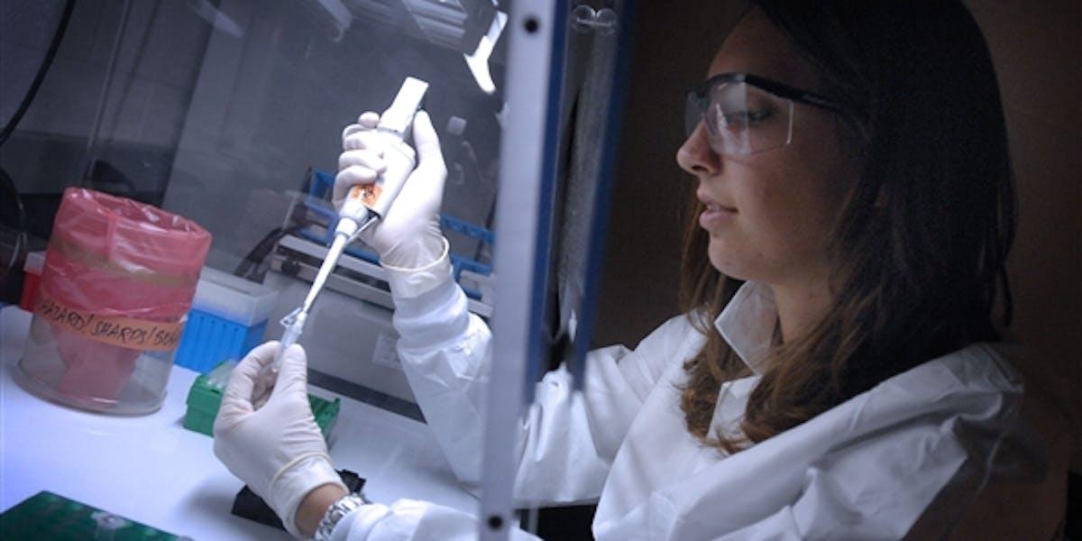A DNA technician.