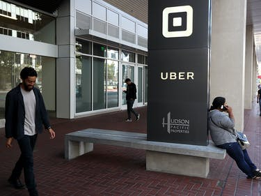 The logo of the ride sharing service Uber is seen in front of its headquarters on August 26, 2016 in San Francisco, California. Uber's head of finance Gautam Gupta is reported to have told investors in a conference call that the company had lost $1.27 billion in the first half of 2016. The ride sharing company lost an estimated $520 million in the first quarter and $720 million in the second quarter.