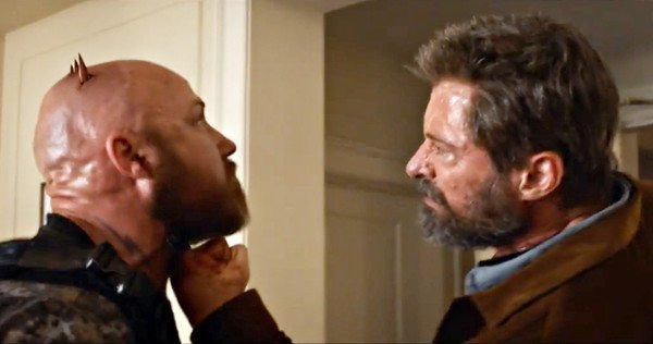 Hugh Jackman slices into a dude's skull as Wolverine in 'Logan'.