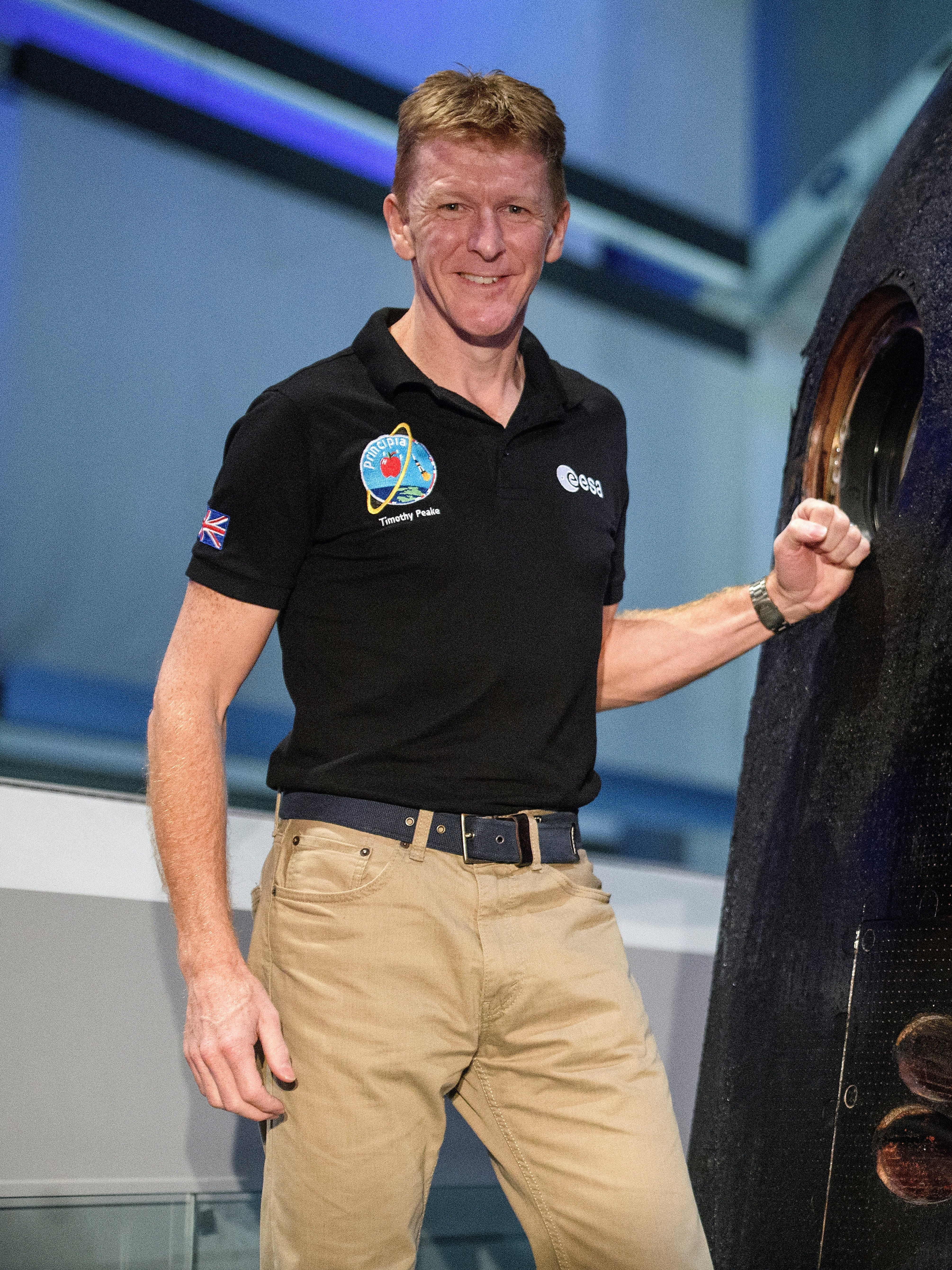 LONDON, ENGLAND - JANUARY 26:  British astronaut Tim Peake poses with the Soyuz TMA-19M descent module which he used to return from the International Space Station, as it is unveiled at the Science Museum on January 26, 2017 in London, England. The Soyuz TMA-19M carried astronauts Yuri Malenchenko (Commander, Russia), Tim Kopra (Flight Engineer, USA) and Tim Peake (Flight Engineer, UK) to the International Space Station on 15 December 2015 and returned the same crew to Earth on 18 June 2016. Major Peake also announced that he is to return to space on a second mission to the International Space Station. (Photo by Leon Neal/Getty Images)