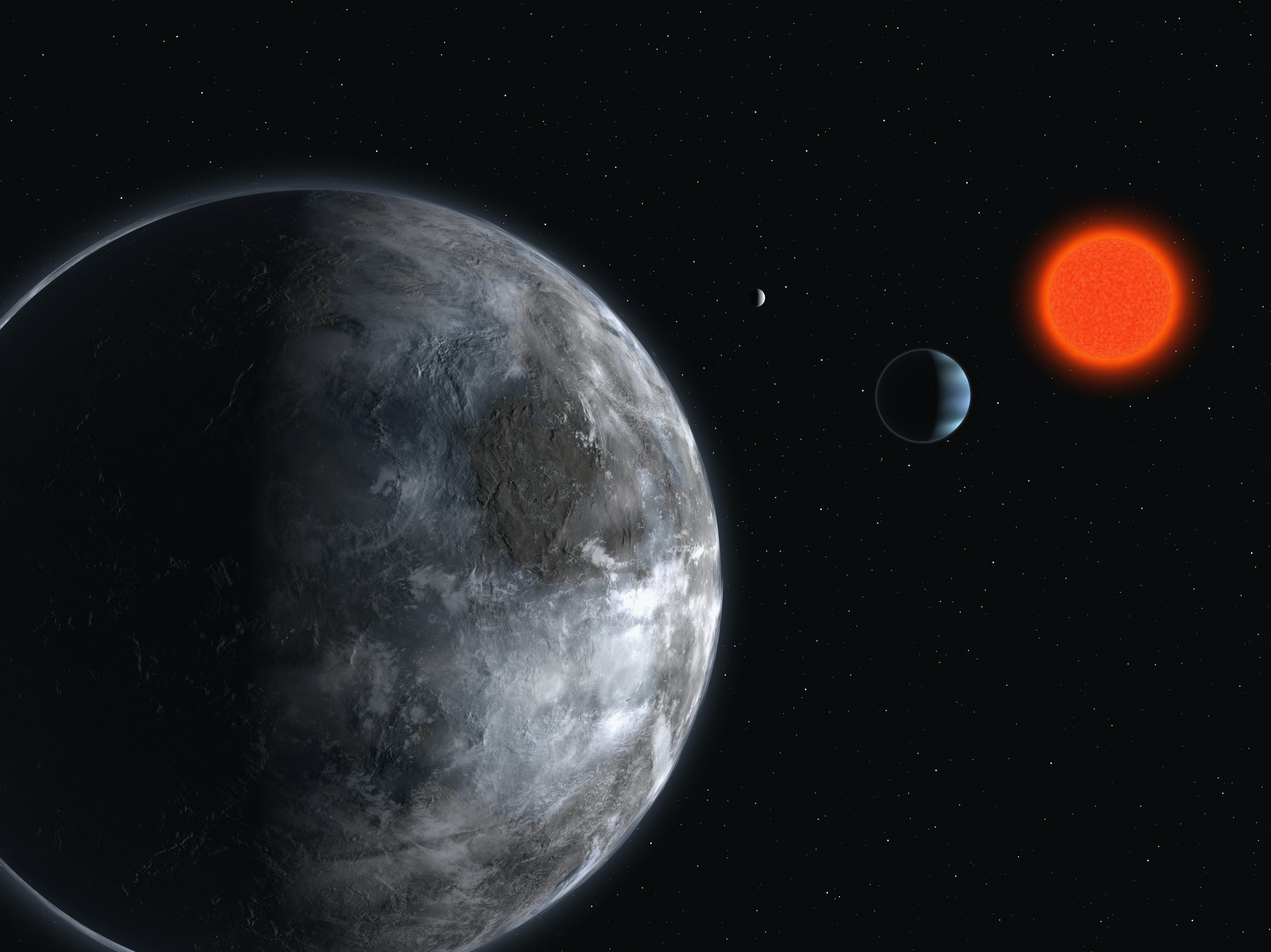 An artist's impression of the planetary system around the red dwarf, Gliese 581, showing what astronomers believe is one of the most earth like planets found outside our solar system.  The planet may have water running on it's surface, and is 20.5 light-years away in the constellation Libra. (Photo by ESO via Getty Images)