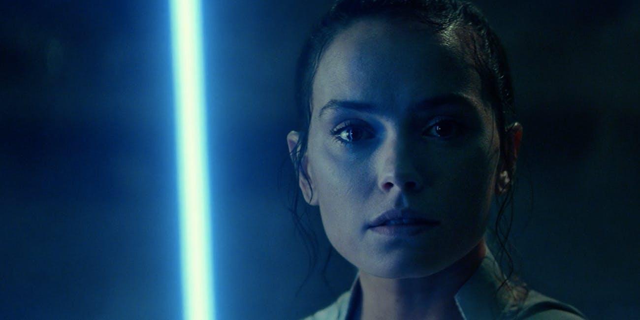 Rey with the Skywalker lightsaber in 'The Rise of Skywalker'