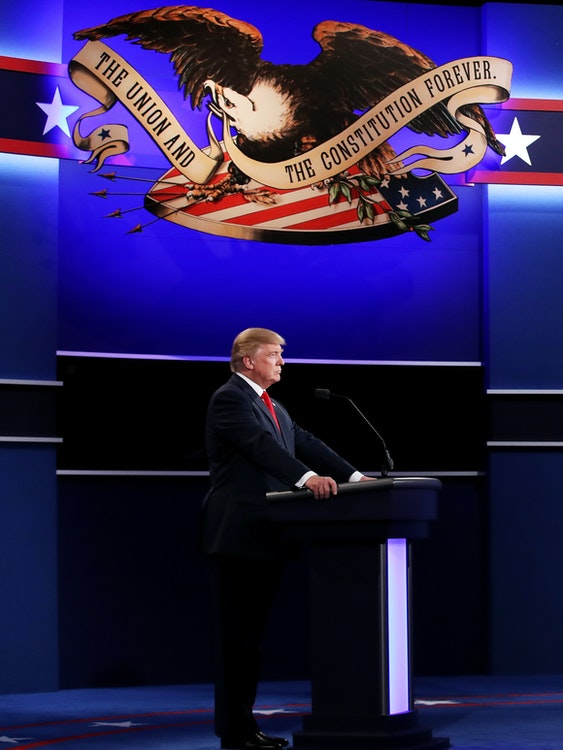 Democratic presidential nominee former Secretary of State Hillary Clinton (R) speaks as Republican presidential nominee Donald Trump looks on during the third U.S. presidential debate at the Thomas & Mack Center on October 19, 2016 in Las Vegas, Nevada. Tonight is the final debate ahead of Election Day on November 8.