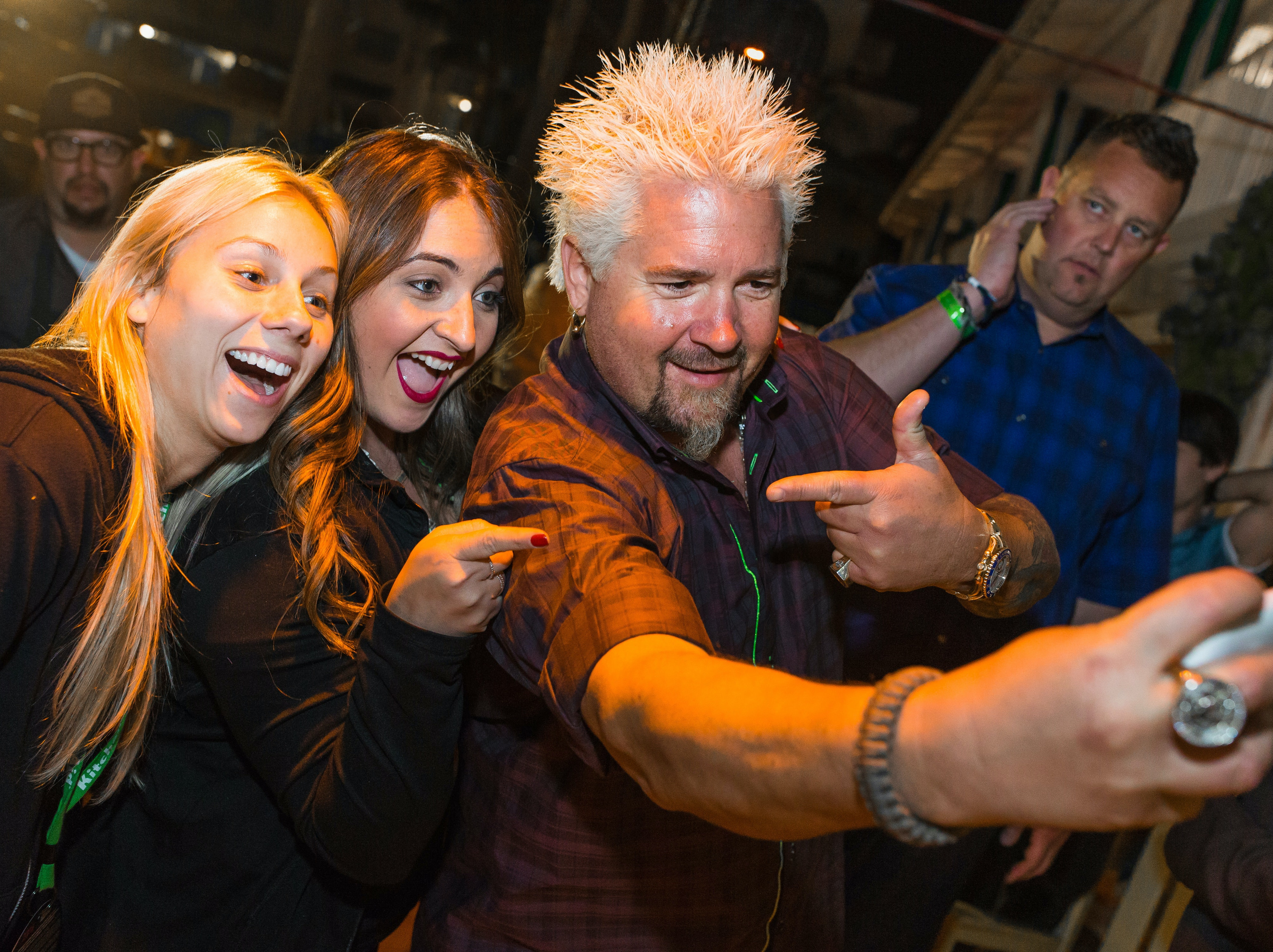 Guy Fieri poses with guests at the 2016 Food Network & Cooking Channel South Beach Wine & Food Festival Presented By FOOD & WINE at Surfcomber Hotel on February 27, 2016 in Miami Beach, Florida.  (Photo by Dylan Rives/Getty Images for SOBEWFF®)
