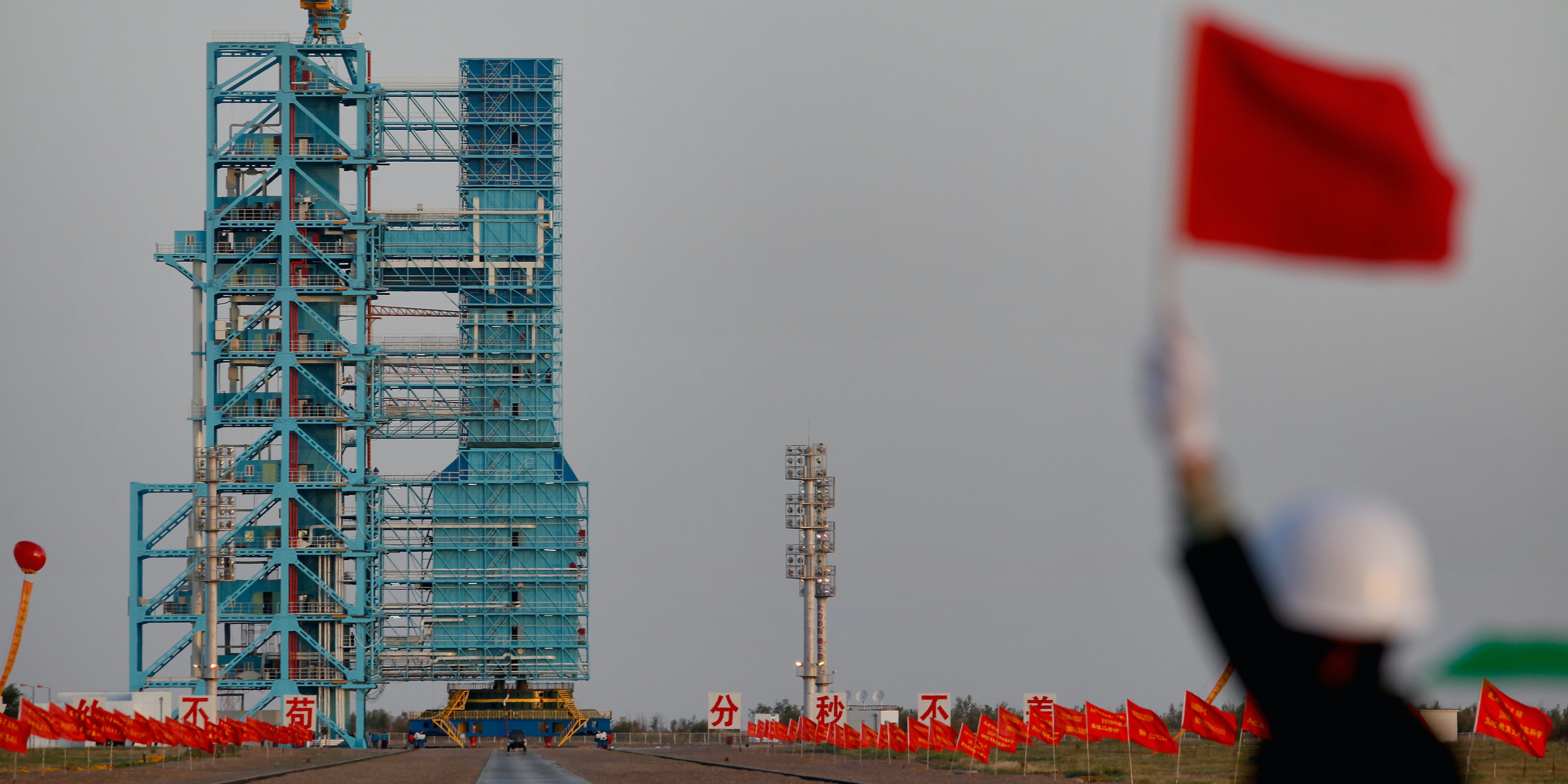 JIUQUAN, CHINA - SEPTEMBER 29:  A Long March 2F rocket carrying the country's first space laboratory module Tiangong-1 prepares to lift off from the Jiuquan Satellite Launch Center on September 29, 2011 in Jiuquan, Gansu province of China. The unmanned Tiangong-1 will stay in orbit for two years and dock with China's Shenzhou-8, -9 and -10 spacecraft with the eventual goal of establishing a manned Chinese space station around 2020.  (Photo by Lintao Zhang/Getty Images)