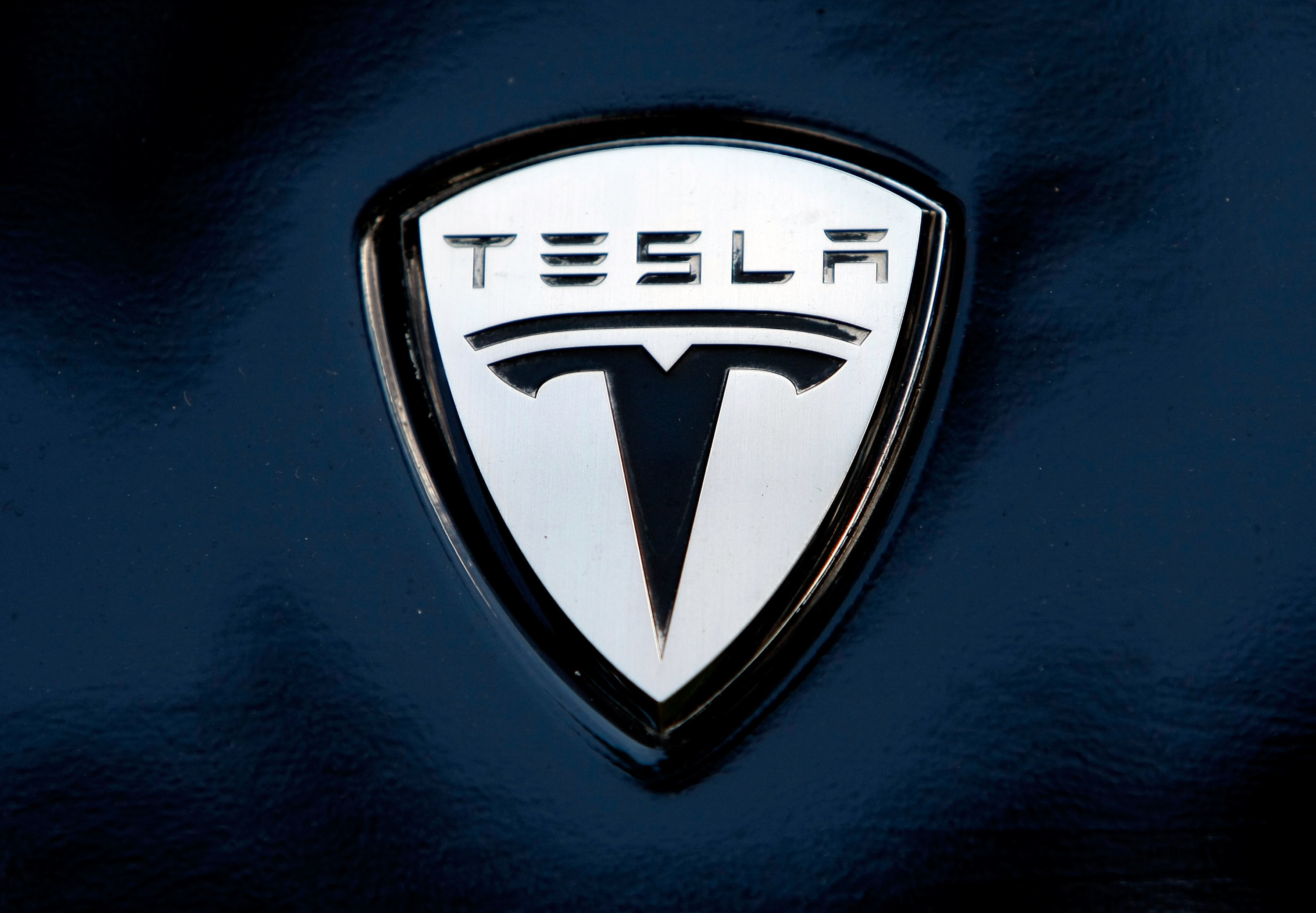 What Does The Tesla Logo Represent Elon Musk Just Confirmed Hidden Meaning Inverse