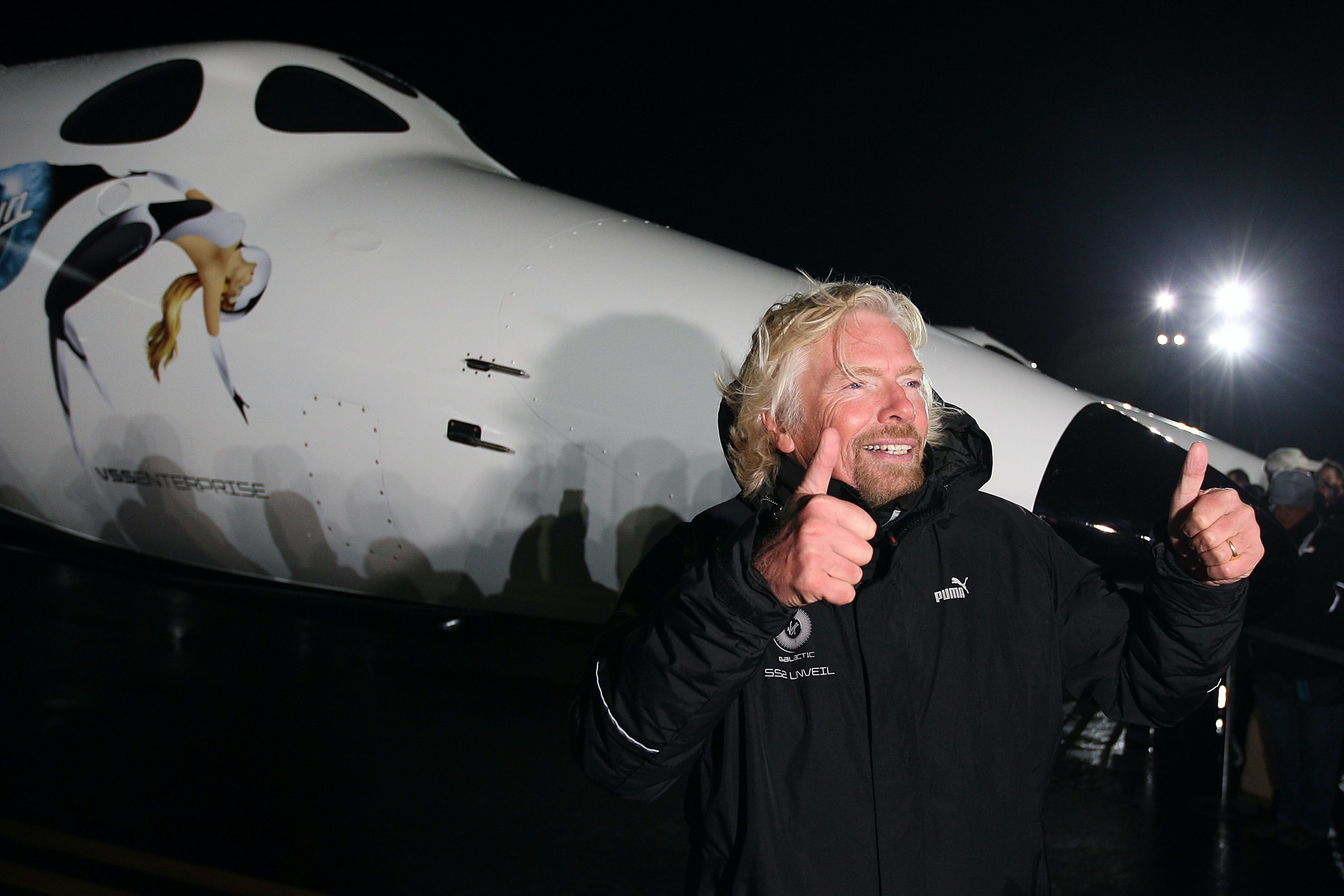Sir Richard Branson gestures to reporters as Virgin Galactic unveils its new SpaceShipTwo spacecraft at the Mojave Spaceport back on December 7, 2009 near Mojave, California.