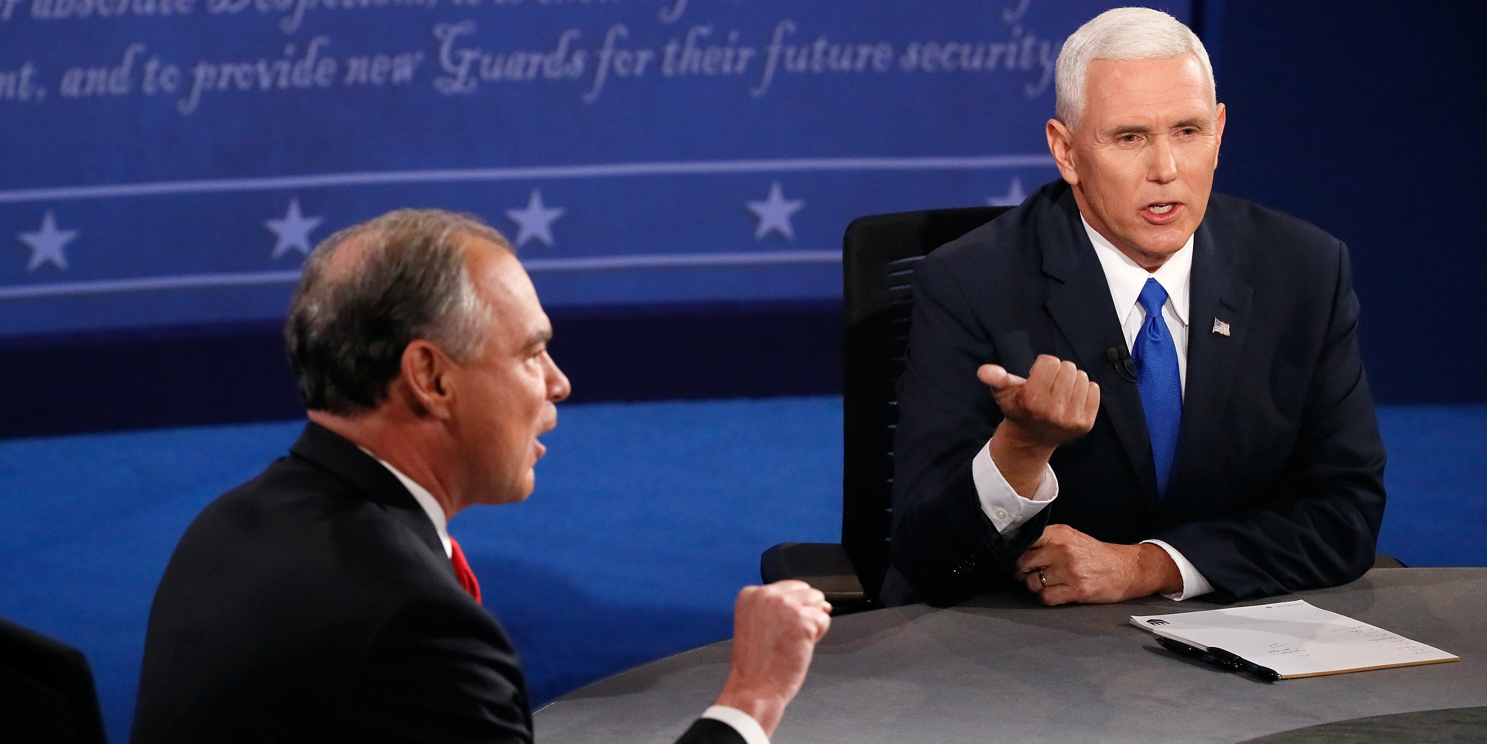 Democratic vice presidential nominee Tim Kaine (L) and Republican vice presidential nominee Mike Pence (R) speak during the Vice Presidential Debate at Longwood University on October 4, 2016 in Farmville, Virginia. This is the second of four debates during the presidential election season and the only debate between the vice presidential candidates.