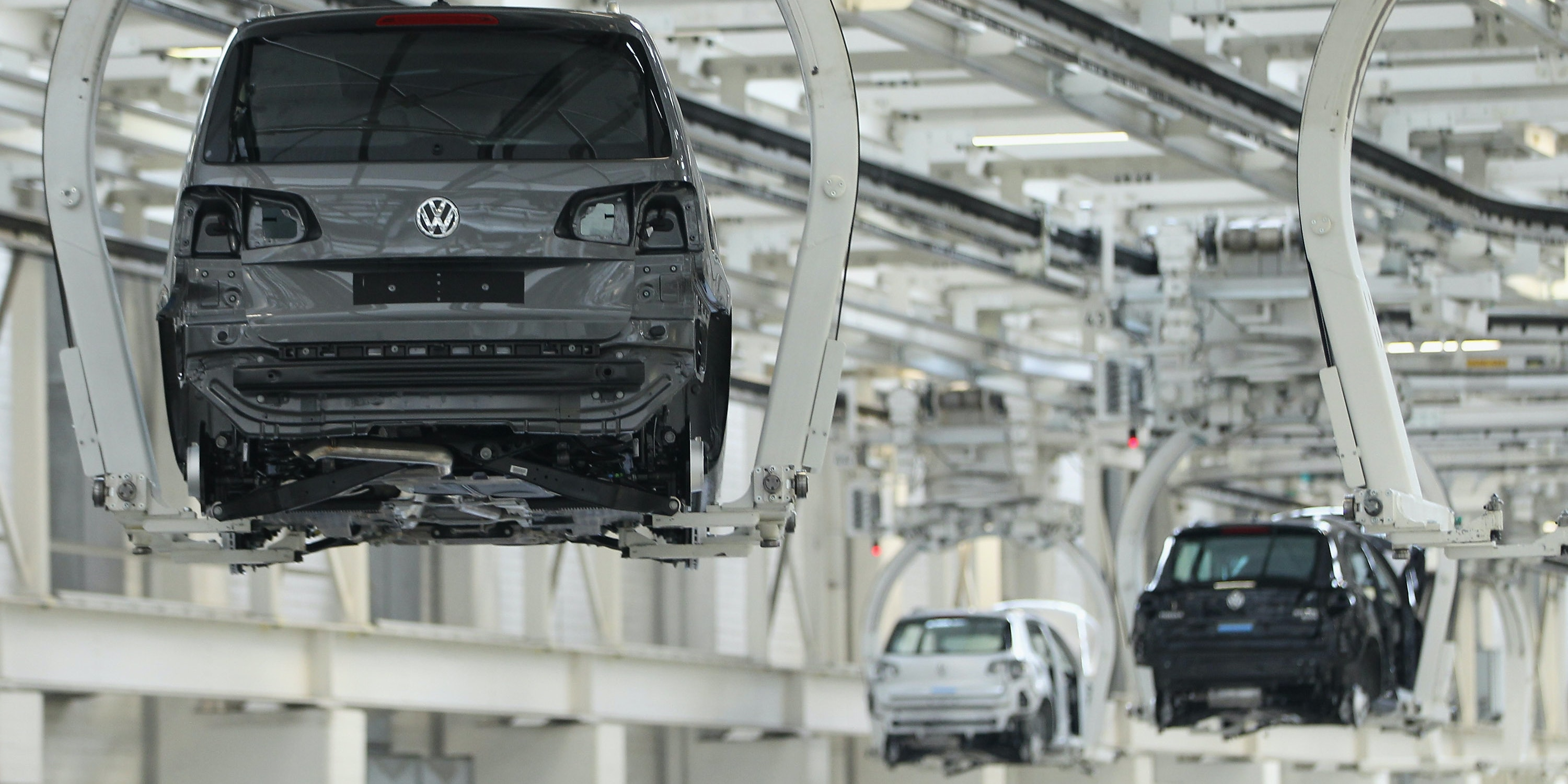 Automated conveyors move partially-assembled Volkswagen Touran and Tiguan cars at the Volkswagen factory on March 7, 2012 in Wolfsburg, Germany. In 2011 Volkswagen achieved record results, with profits of EUR 15.8 million and production of over 8 million cars worldwide.