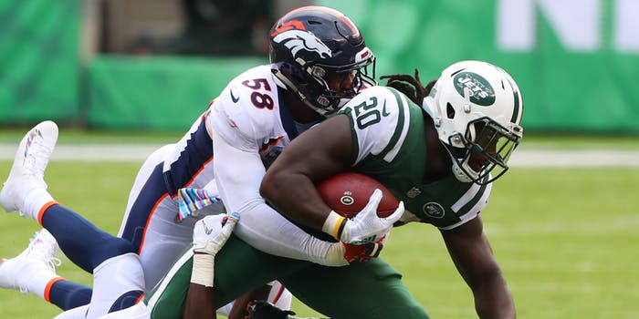 New York Jets running back Isaiah Crowell (20) is tackled by Denver Broncos linebacker Von Miller (58) during the National Football League game between the New York Jets and the Denver Broncos on October 7, 2018 at MetLife Stadium in East Rutherford, NJ.