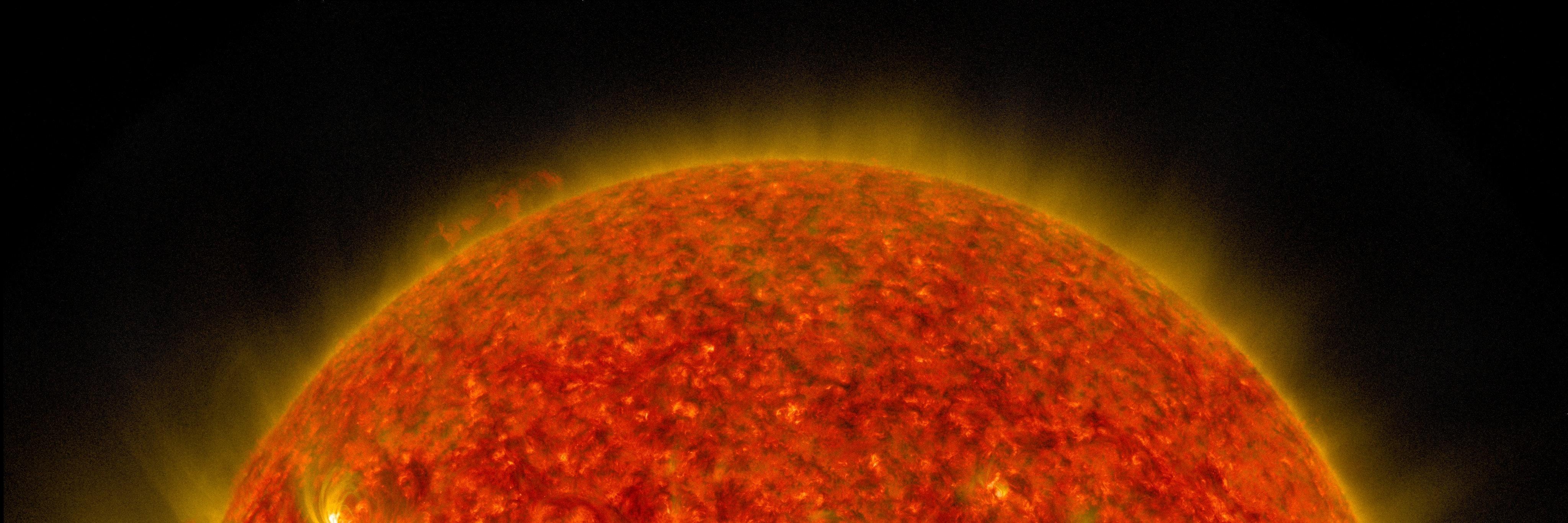 NASA's SDO Sees a Solar Flare and a Lunar Transit
