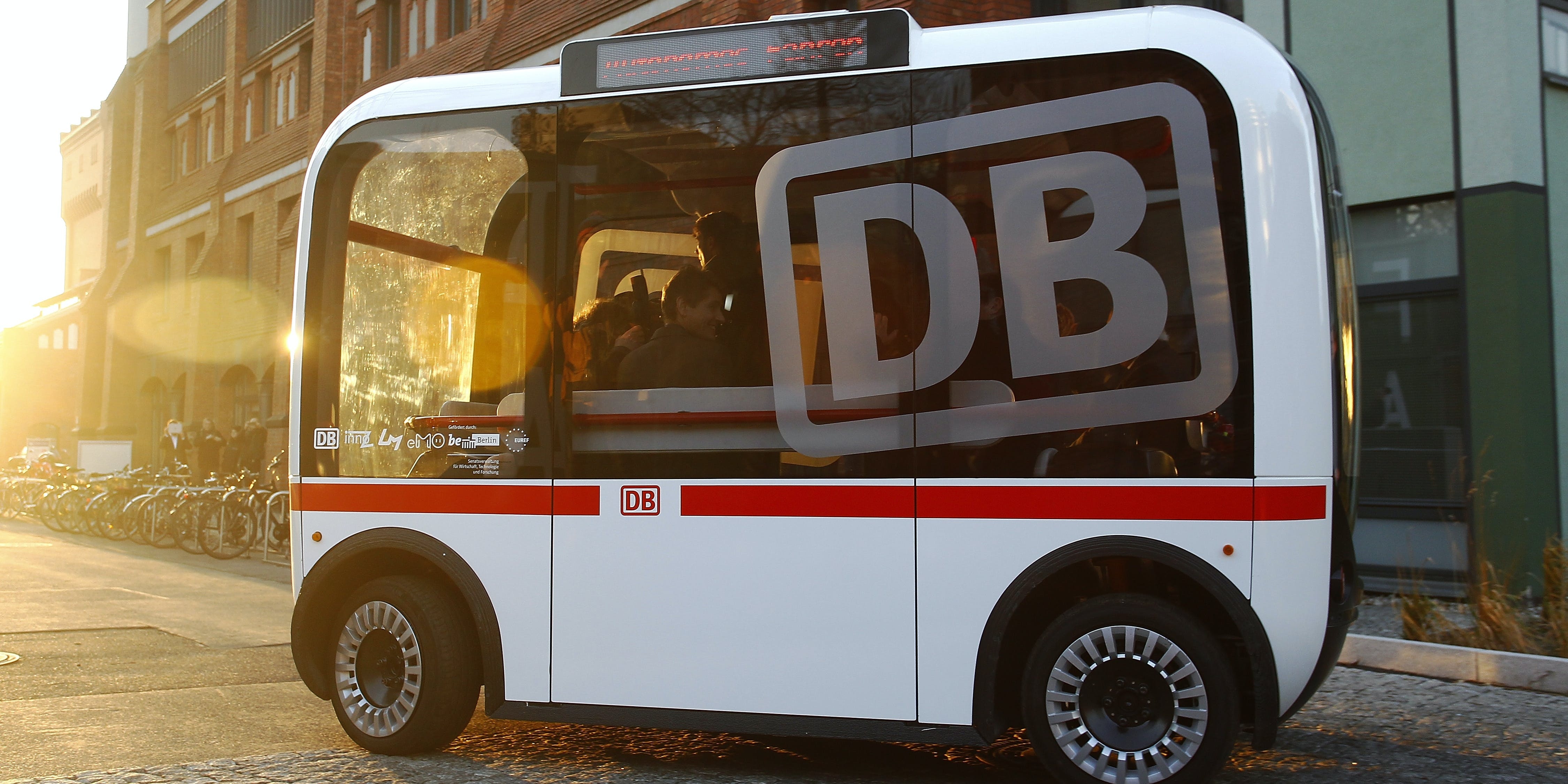 BERLIN, GERMANY - DECEMBER 16:  German Transport Minister Alexander Dobrindt and Deutsche Bahn head Ruediger Grube sit in a self driving Bus during  the presentation of a pilot project by Deutsche Bahn to demonstrate a self-driving public bus on December 16, 2016 in Berlin, Germany. The project is a collaboration between Deutsche Bahn and Berlin's Technical University at the university's EUREF campus.  (Photo by Michele Tantussi/Getty Images)